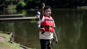 """""""I'm Hooked"""" participant holds up his first catch."""