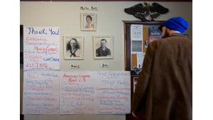 Papers hung on the wall during a celebration for the A Home for Every Veteran initiative Feb. 24, 2017, show the service providers and elected officials who were key to the effort's success.