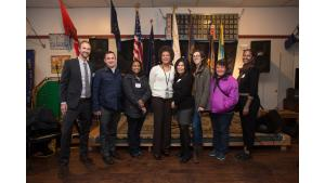 Home Forward employees pose for a picture during a celebration of the A Home for Every Veteran initiative.