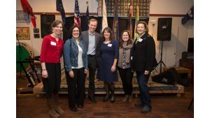 Employees of the Joint Office of Homeless Services take a photo with Multnomah County Commissioners Jessica Vega Pederson and Sharon Meieran during a celebration for the A Home for Every Veteran initiative.