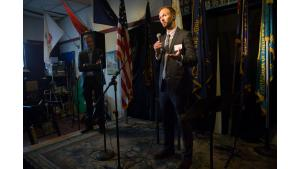 Ian Davie, right, chief operating officer for Home Forward, speaks at a celebration for the A Home for Every Veteran initiative while Joint Office of Homeless Services director Marc Jolin looks on.