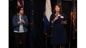 Multnomah County Commissioner Sharon Meieran, right, speaks at a celebration for the A Home for Every Veteran initiative while Commissioner Jessica Vega Pederson looks on.