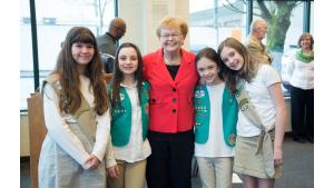 Former Governor Barbara Roberts poses with local girl scout troop
