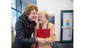 Former Commissioner Diane McKeel and former Governor Barbara Roberts greet each other with hugs