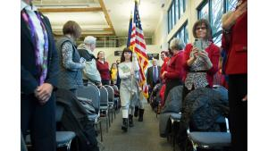 Local Girl Scouts carry flags and lead pledge of allegiance at renaming ceremony