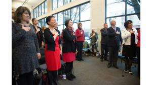 Guests at event stand for pledge of allegiance