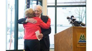 Former Governor Barbara Roberts hugs historian, writer and professor Chet Orloff