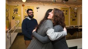 Multnomah County Chair Deborah Kafoury hugs Philip J. Wolfe, a member of the Portland Commission on Disability, at the Q Center on March 18, 2017.