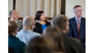 Bobby Lee, Jessica Vega Pederson and Mayor Ted Wheeler listen to speakers.