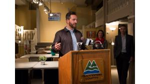 Jonathan Malsin of Beam Development speaks Monday, April 17, at the opening of the new home of the Columbia shelter, in the Shleifer Furniture building.