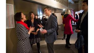 Multnomah County District 3 Commissioner Jessica Vega Pederson, left, talks with District 1 Commission Sharon Meieran and Jonathan Malsin of Beam Development during the Monday, April 17, opening of the Columbia shelter at the Shleifer Furniture building.