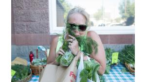 Tonya Bradshaw stops to smell the greens when she comes to pick up her farm share.
