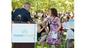 Chair Deborah Kafoury shakes hands with Mayor Ted Wheeler at a housing rally July 28, 2017.