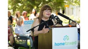 Annie Calhoun, a Home Forward public housing resident, says a stable home saved her life. She spoke at a housing rally July 28, 2017.