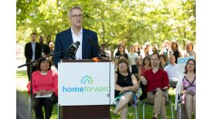 Portland Mayor Ted Wheeler speaks during a rally against threatened federal cuts to housing programs July 28, 2017, at McCoy Park in New Columbia.