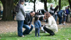 Multnomah County Chair Deborah Kafoury chats with Som Subedi and his family at the Sept. 17 event.