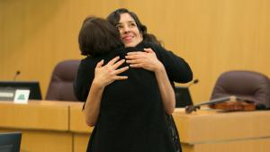 Multnomah County's Chief Operating Office Marissa Madrigal hugs Commissioner Jessica Vega Pederson during the 2017 celebration for Hispanic and Latinx Heritage Month.