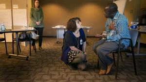 Samira Sario, a refugee resettlement case manager at Catholic Charities, roleplays with Multnomah County Health staffer Eugene Sadiki