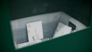Ballots are returned to a green ballot drop box inside the Multnomah County Duniway-Lovejoy Elections Building
