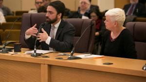 John Wasiutynski, director of the Office of Sustainability and  Dr. Jae Douglas, director of environmental health services in Multnomah County speak before board at Dec 21 meeting