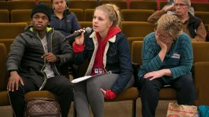 Emma Cooper, center, says schools need more — and more confidential — mental health services