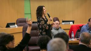 Chair Kafoury Takes Questions during a forum on energy efficiency, Kafoury seen standing as the audience raises their hands to ask questions.