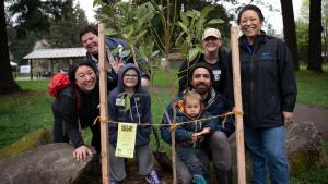 Commissioner Lori Stegmann, far right, joins Multnomah County staff to plant trees in honor of Earth Month