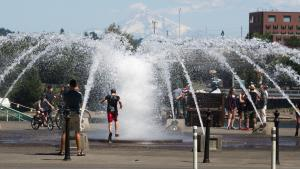On the first hot days of Spring, local fountains offer a cool reprieve