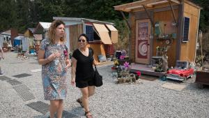 Commissioner Lori Stegmann, right, during a tour of Kenton Women's Village in August 2018.