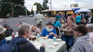 Bob, center, smiles during the Parking Lot Eat & Greet for Wy'east shelter residents and neighbors.
