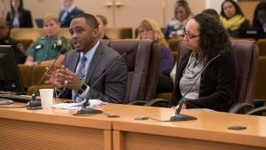 Epidemiologist Frank Franklin, Ph.D., left, briefs the Board on leading causes of death in Multnomah County alongside Public Health Director Rachael Banks.
