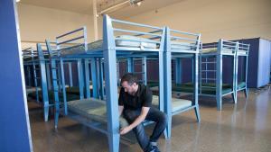 Matt Olguin of Transition Projects adjusts bunks at the Walnut Park shelter on Monday, Nov. 19, 2018.