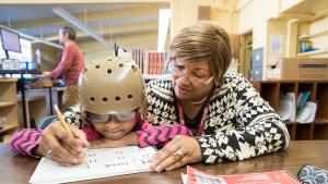 Foster grandparent helping child