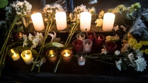 Candles and flowers to honor those who died experiencing homelessness