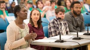 Community members testifying at a public budget hearing in 2019