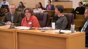 Laura Golina de Lovato, second from left, executive director of Northwest Pilot Project