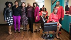 From left: Multnomah County's Ebony Clarke, Erika Preuitt, Chair Deborah Kafoury, Lakeesha Dumas, Commissioner Sharon Meieran, Regina Penny, Bonnie Johnson and Latoya Manlove pose for photo in Diane Wade House salon.