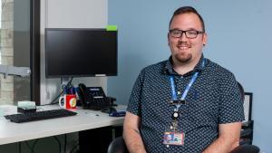 Tim Criswell, the insurance navigator at Multnomah County's STD Clinic, helps make sure patients don't have to pay for PrEP
