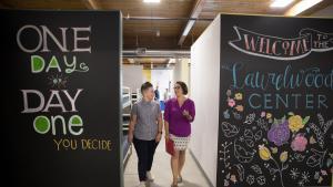 Stacy Borke, left, and Commissioner Jessica Vega Pederson inside the Laurelwood Center on Monday, Aug. 12, 2019.