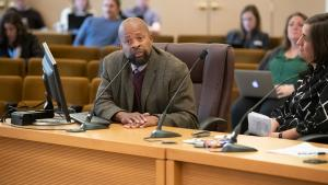 Yugen Rashad testifies at a 2019 board meeting on flavored tobacco an vaping products.