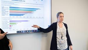 Senior Epidemiologist Taylor Pinsent walks reporters through the COVID-19 data dashboard.