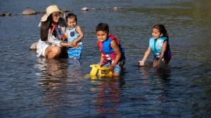 Talia Reasoner takes her kids to play in the Sandy River, and she teaches them how to play safely.