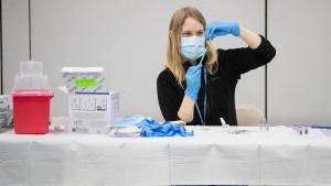 Public Health nurse prepares vaccine for a COVID-19 vaccination clinic