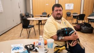 Chris Doll and his dog Junior came to Multnomah County East Building Cooling Center to avoid heat, July 29, 2021