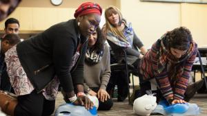Participants learning disaster preparedness techniques at a culturally specific disaster preparedness training