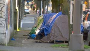photo of tents on a street sidewalk