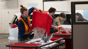 Election workers receive ballots at the Multnomah County Duniway-Lovejoy Elections Building during the November 2020 General Election