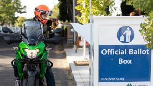 motorcyclist dropping ballot at drop site