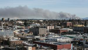 Picture of City of Portland skyline with smoke moving across it due to Scrap Yard Fire
