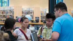 Meh Taw and Tun Myin sign up for new library cards